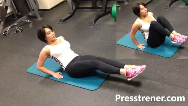 Подтягивание ног к животу груди сидя